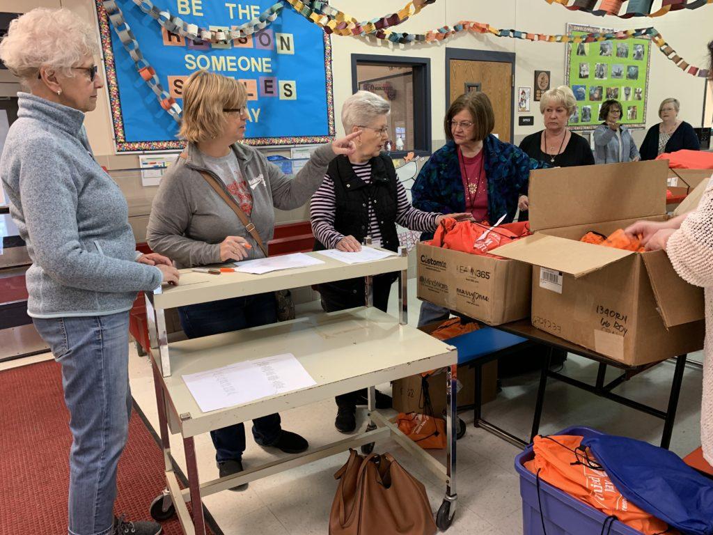 Volunteers unpacking boxes