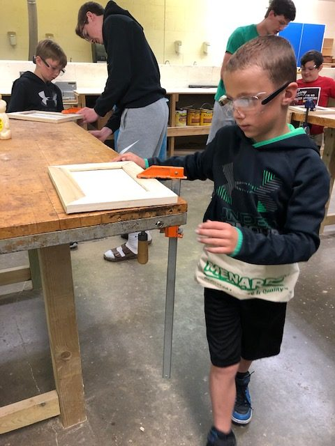 Student making a frame