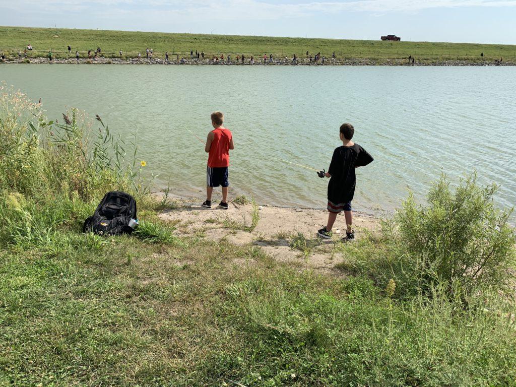 Students fishing at bank of Johnson Lake