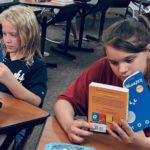 students reading new books